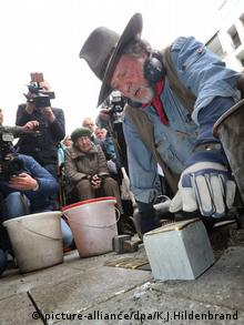 Gunter Demnig laying down a stolperstein in Augsburg, Germany