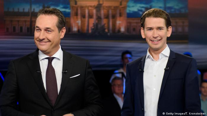 Heinz-Christian Strache and Sebastian Kurz smile in a TV studio