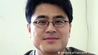 Portrait photo of another jailed dissident Shi Tao (Moderne Handelszeitung)