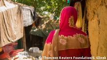 Female fixer Noor lives in the same community as many of the prostitutes and facilitates their client appointments over the phone in Kutupalong, Bangladesh on 15 October 2017. Thomson Reuters Foundation/Stefanie Glinski
