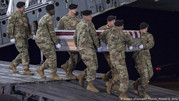 American soldiers carry the remains of one of their comrades.