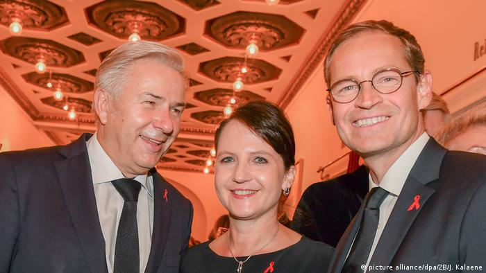 Former Berlin Mayor Klaus Wowereit, current Berlin Mayor Michael Müller and his wife Claudia attend the AIDS gala