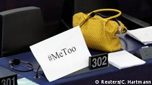 A placard with the hashtag MeToo is seen on a European Parliament member's desk during a debate to discuss preventive measures against sexual harassment and abuse in the EU at the European Parliament in Strasbourg, France, October 25, 2017. REUTERS/Christian Hartmann