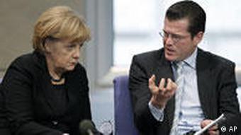 Angela Merkel, left, with Karl-Theodor zu Guttenberg in the Bundestag