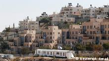 Buildings forming part of Nof Zion, a Jewish settler enclave, are seen in the foreground as buildings from the Palestinian neighbourhood of Jabel Mukaber are seen in the background, in East Jerusalem October 25, 2017. REUTERS/Ammar Awad