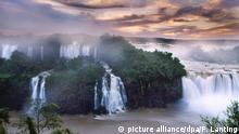 Waterfalls at sunset, Iguacu Falls National Park, Brazil PLEASE NOTE: 1. pre-approval required from Image Provider for use of photographer's name in product title. 2. pre-approval required from content provider for use in a retail print or poster. 3. pre-approval required from content provider for use in a greeting card (including electronic greeting cards). 4. pre-approval required from content provider for use in book where more than 25% of the pages contain images by this photographer. 5. pre-approval required from content provider for use in a retail calendar where more than 80% of images used were created by this photographer. |