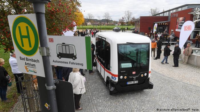 A bus stop with the autonomous, electric bus
