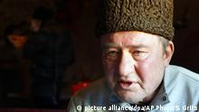 In this photo taken on Monday, Jan. 25, 2016, Crimean Tatar leader Ilmi Umerov speaks during an interview to the Associated Press in Simferopol, Crimea. A court in the Russia-occupied Crimea on Wednesday, Sept. 27, 2017 sentenced Ilmi Umerov, former deputy chairman of the Crimean Tatars' representative body Mejlis, to two years in prison for comments he made about the annexation on television. (AP Photo/Sergei Grits) |