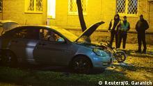 25.10.2017 Investigators work at the site of a car explosion in central Kiev, Ukraine October 25, 2017. REUTERS/Gleb Garanich