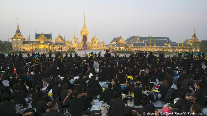 Mourners gathered at dawn in Bangkok for the royal cremation