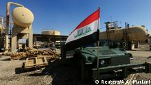 FILE PHOTO: An Iraqi flag is seen on a military vehicle at an oil field in Dibis area on the outskirts of Kirkuk, Iraq October 17, 2017. REUTERS/Alaa Al-Marjani/File Photo