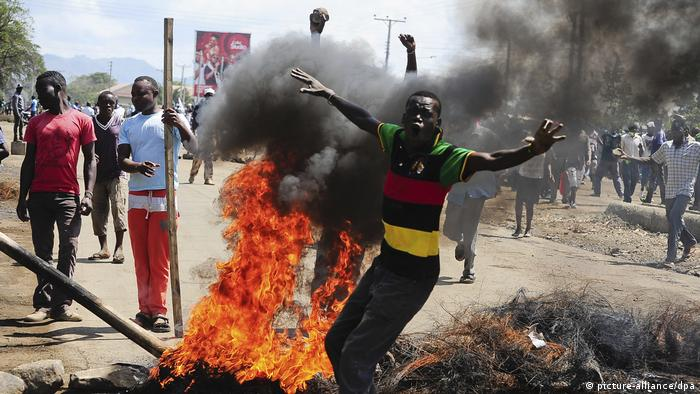 Odinga supporters protesting next to burning tyres