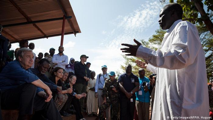 United Nations Secretary General Antonio Guterres listens to Muslim community leader Ali Idriss at an IDP camp in DRC