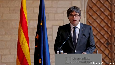 Catalan President Carles Puigdemont speaks to reporters on October 26