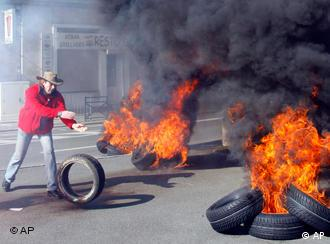 Continental employees burn tyres during a demonstration in Compiegne, north of Paris, Thursday March 19, 2009.