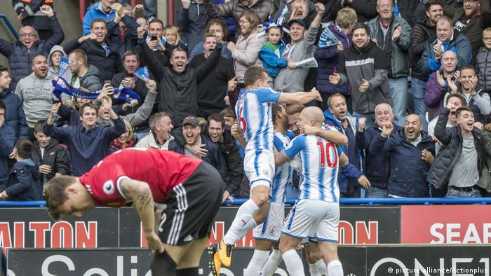 Huddersfield players celebrate beating Manchester United