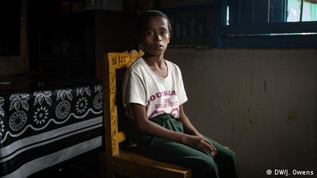 Rohingya boy sitting on a chair