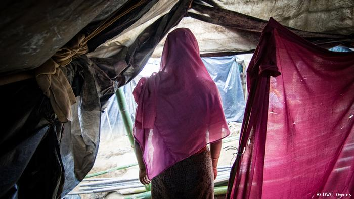 Girl standing at the entrance of a tent