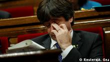 Catalan President Carles Puigdemont gestures during a plenary session at the Catalan regional Parliament in Barcelona, Spain, October 27, 2017. REUTERS/Albert Gea