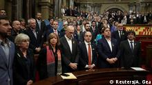 Catalan government and pro independence deputies sing the Catalan anthem after the Catalan regional Parliament declared inpendence from Spain in Barcelona, October 27, 2017. REUTERS/Albert Gea