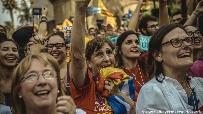 Supporters of independence rejoice outside of the Catalan parliament in Spain