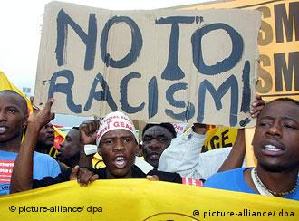 Protesters at the UN world conference against racism in Durban, South Africa in 2001 holding up a sign saying No to Racism