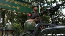 Myanmar soldiers stand guard in Maungdaw in Myanmar's northern Rakhine state (Getty Images/AFP)