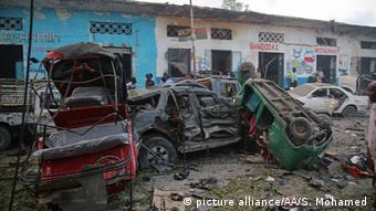 Cars were turned upside down by the bomb blasts in Mogadishu