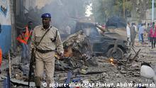 28.10.2017*** Somali soldier walk near wreckage of vehicles after a car bomb was detonated in Mogadishu, Somalia Saturday, Oct 28, 2017. A suicide car bomb exploded outside a popular hotel in Somalia's capital on Saturday, killing at least 10 people and wounding more than 11, while gunfire could be heard inside, police said. A second blast was heard in the area minutes later. (AP Photo/Farah Abdi Warsameh) |