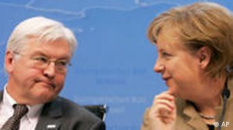 German Foreign Minister Frank-Walter Steinmeier and Chancellor Angela Merkel at a conference.