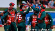 Bangladesh bowler Shakib Al Hasan (C,L) celebrates the dismissal of South African batsman Mangaliso Mosehle (not in picture) during the second T20 Match between South Africa and Bangladesh on October 29, 2017 in Potchefstroom, South Africa. / AFP PHOTO / GIANLUIGI GUERCIA (Photo credit should read GIANLUIGI GUERCIA/AFP/Getty Images)