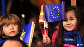 Children wave national and EU flags during the central rally of the opposition Social Democrats