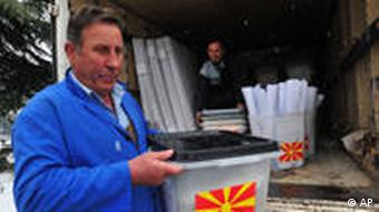 Workers distribute electoral material to a polling station in Skopje
