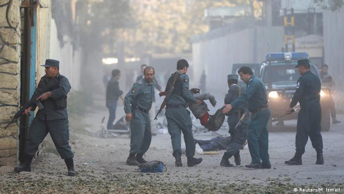 Explosion in Kabul and soldiers are carrying injured people away.