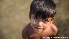A child plays in the lanes of Bhalukali Camp-2 , in Cox's Bazar, Bangladesh, Oct. 25 2017. Photographer: Prashanth Vishwanathan/ DW_Stories