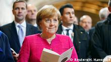 German Chancellor Angela Merkel attends the 500th anniversary of the Reformation in front of the grave of Martin Luther at the Castle Church in Wittenberg, Germany, October 31, 2017. REUTERS/Hannibal Hanschke