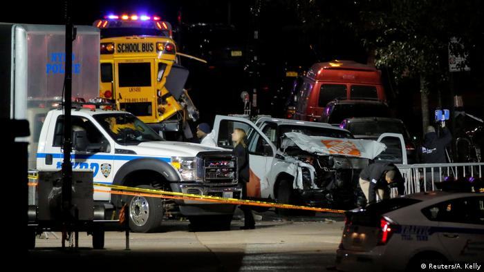A smashed-up Home Depot truck stood next to a police truck, with a badly damaged school bus in the background.