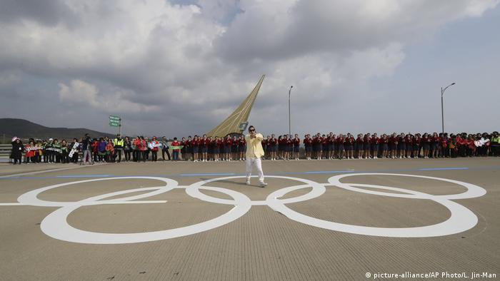 A man performs during the Olympic Torch Relay at Incheon Bridge
