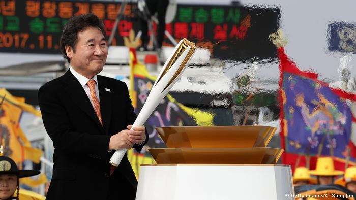 South Korean prime minister Lee Nak-yon holds the PyeongChang 2018 Winter Olympics torch