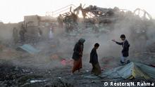 People walk at the site of an air strike in the northwestern city of Saada, Yemen November 1, 2017. REUTERS/Naif Rahma TPX IMAGES OF THE DAY