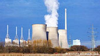 Steam rising from the cooling towers of a combined gas and coal power plant operated by RWE in Germany