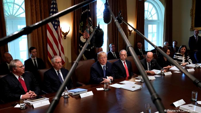 US President Donald Trump speaks during a Cabinet meeting with several microphones in the foreground (Reuters/K.Lamarque )