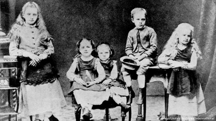 Marie Curie com seus quatro irmãos