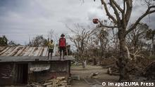 Mar 25, 2015 - , Ifira, Vanuatu - A child and an elderly man stand on the roof of a dwelling damaged Cyclone Pam, on Ifira Island, just off the coast of the main island of Efate. 166,000 people remain affected following the destruction caused by Tropical Cyclone Pam, which hit the South Pacific island nation in March 2015, nearly 60,000 of them are children. The Category 5 storm damaged infrastructure and disrupted key services, putting children s health, safety and education at risk. Vanuatu PUBLICATIONxINxGERxSUIxAUTxONLY - ZUMA 20150325_mda_z03_730 Copyright: xSokhinx Mar 25 2015 Vanuatu a Child and to Elderly Man stand ON The Roof of a Dwelling damaged Cyclone Pam ON Iceland Just off The Coast of The Main Iceland of Efate 166 000 Celebrities Remain Affected following The Destruction CAUSED by Tropical Cyclone Pam Which Hit The South Pacific Iceland Nation in March 2015 parishioners 60 000 of THEM are Children The Category 5 Storm damaged Infrastructure and disrupted Key Services Putting Children S Health Safety and Education AT Risk Vanuatu PUBLICATIONxINxGERxSUIxAUTxONLY Zuma 20150325_mda_z03_730 Copyright xSokhinx