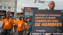 A man holds a banner reading Stop violence against women is also a men's issue during a march against gender violence and femicides in Santo Domingo on November 1, 2017. 74 women have been murdered by their partners or ex-partners so far this year in Dominican Republic. / AFP PHOTO / Erika SANTELICES (Photo credit should read ERIKA SANTELICES/AFP/Getty Images)