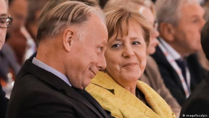 Юрген Триттин и Ангела Меркель
