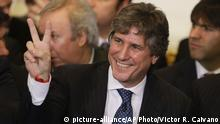 FILE- In this July 31, 2014, file photo, Argentina's Vice President Amado Boudou gestures to supporters before the speech of Argentine President Cristina Fernandez at Casa Rosada Presidential Palace in Buenos Aires, Argentina. Boudou is facing trial on charges of bribery and conducting business incompatible with public office. The trial began Tuesday, Oct. 3 2017. (AP Photo/Victor R. Caivano, File) |