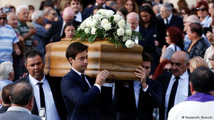 Journalist Daphne Caruana Galizia's sons Matthew and Paul carry the coffin of their mother