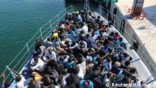 Migrants arriving at a Tripoli naval base after being intercepted by coastguards