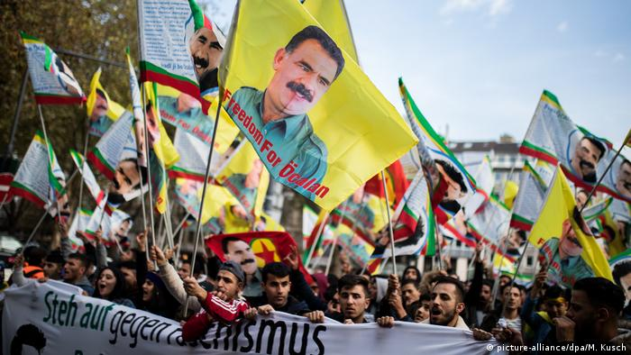 Kurdish protesters march with Ocalan flags in Dusseldorf.
